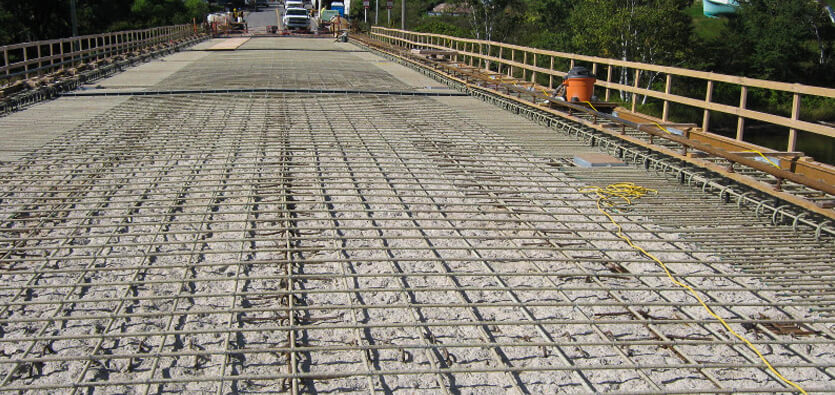 Advanced Composites For Rehabilitation Of Structurally Deficient Concrete Infrastructure